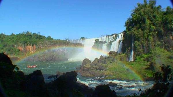 Argentina Iguazu Falls wide angle with rainbow and boat Royalty-free stock video