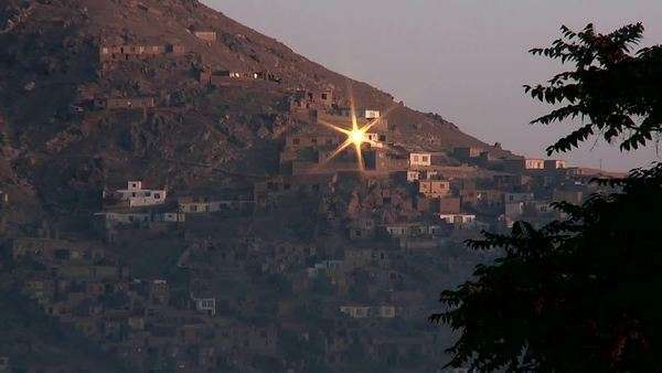 Sun reflects from a hillside window in Kabul, Afghanistan. Royalty-free stock video