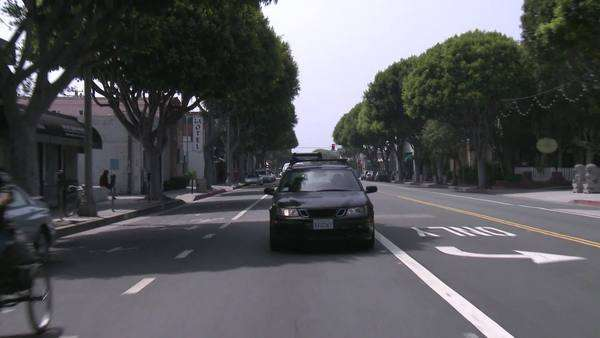 A vehicle drives through a business district of Santa Monica, California. Royalty-free stock video