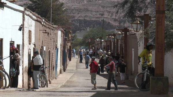 Slow move in on pedestrians in San Pedro de Atacama Chile. Royalty-free stock video