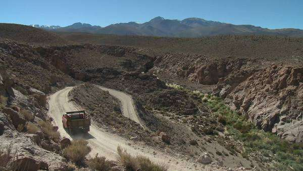 A truck on a winding dirt road in the altiplano above San Pedro de Atacama Chile. Royalty-free stock video