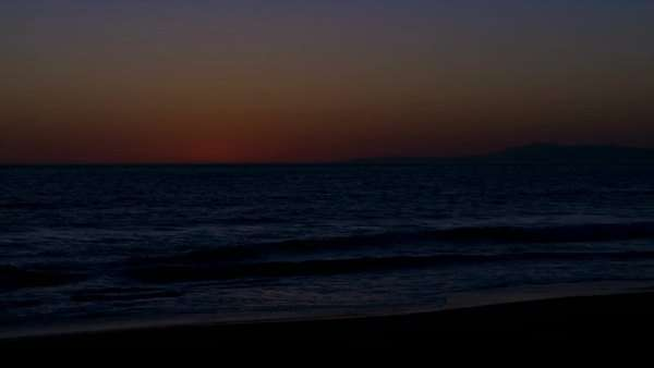Timelapse of sun setting over the ocean. Royalty-free stock video