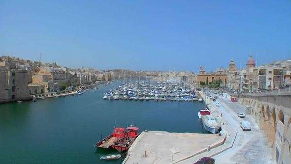 Wide view of Malta's old city scape and ships in the harbor. Royalty-free stock video