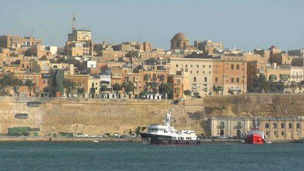 View of Malta's old city scape with a ship coming into the harbor. Royalty-free stock video