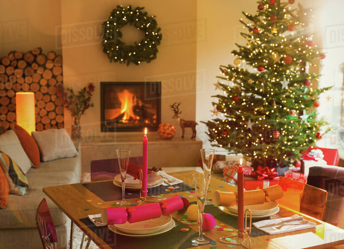 Christmas Fire Place Images.Ambient Dining Table Fireplace And Christmas Tree In Living Room Stock Photo