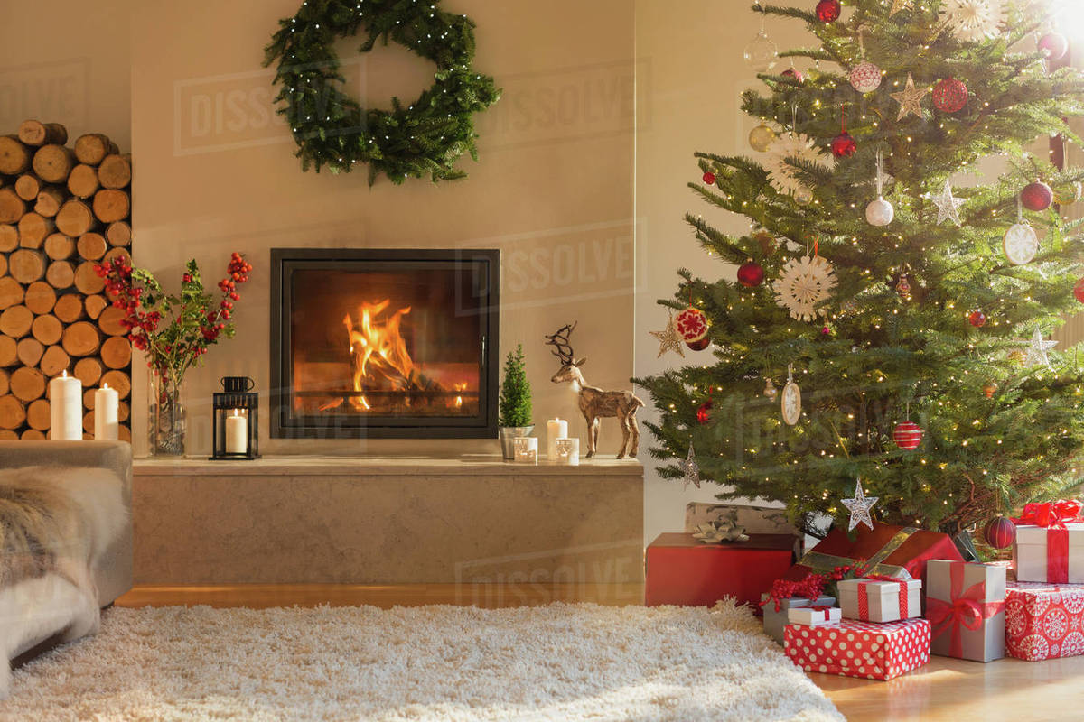 Ambient Fireplace And Christmas Tree In Living Room Stock Photo