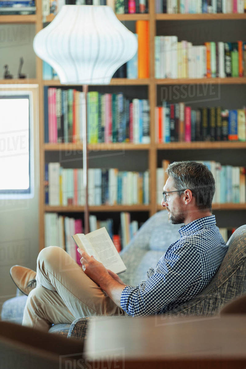 Man relaxing, reading book Royalty-free stock photo