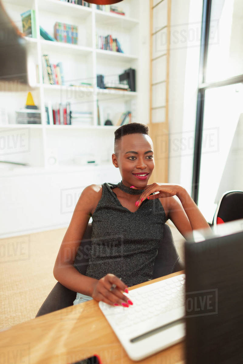 Young woman using computer, working from home in office Royalty-free stock photo