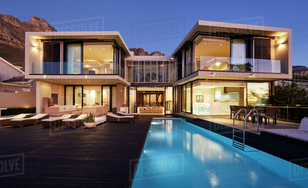 Modern Luxury Home Showcase Exterior And Swimming Pool Illuminated At Night Stock Photo Dissolve