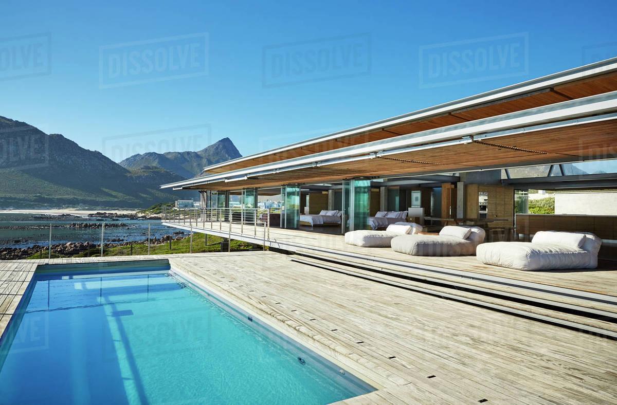 Modern Luxury Hotel Swimming Pool Under Sunny Blue Sky Stock Photo