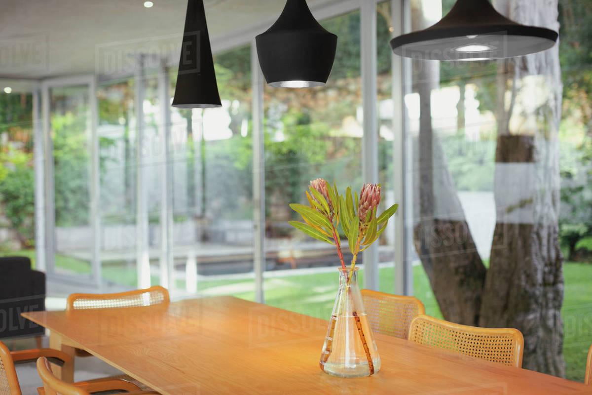 Modern black pendant lights hanging over bouquet on dining room D1007_9_233