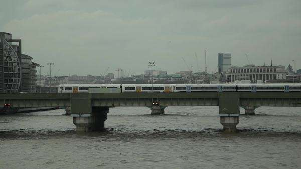 Trains cross bridge on River Thames Royalty-free stock video