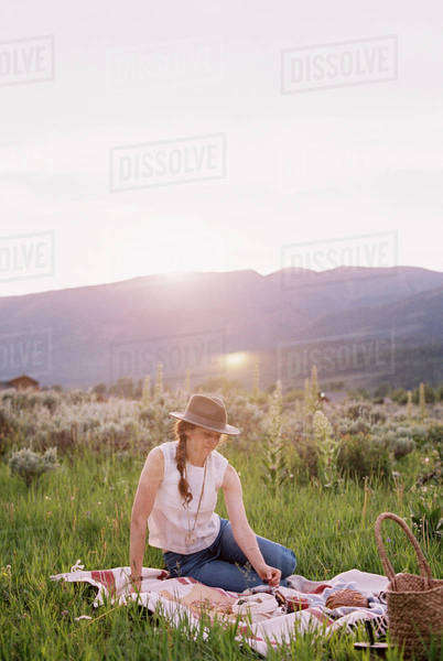 Woman having a picnic on a meadow. Royalty-free stock photo