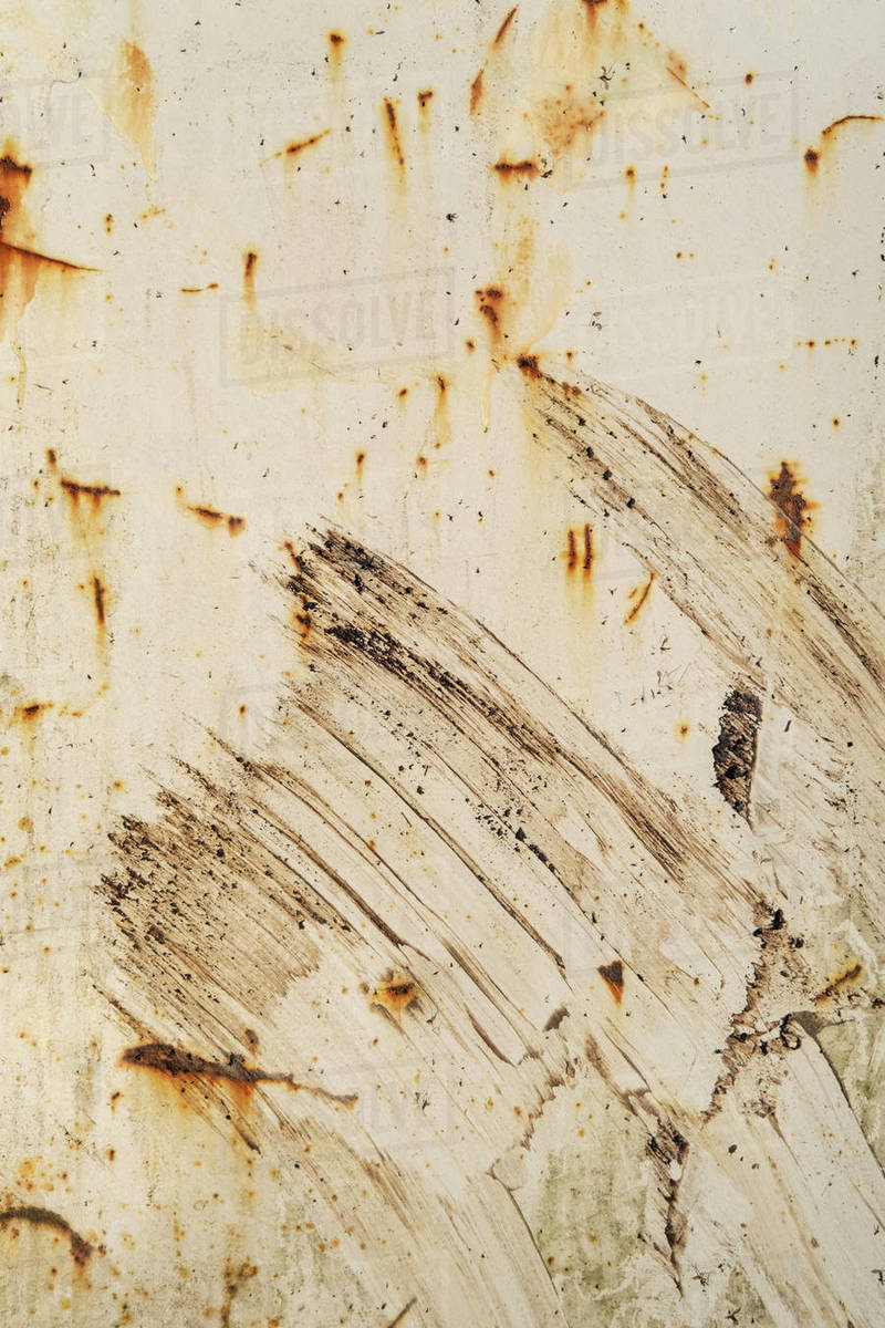 Close up of rusty, dirty metal wall, focus on scratch marks Royalty-free stock photo