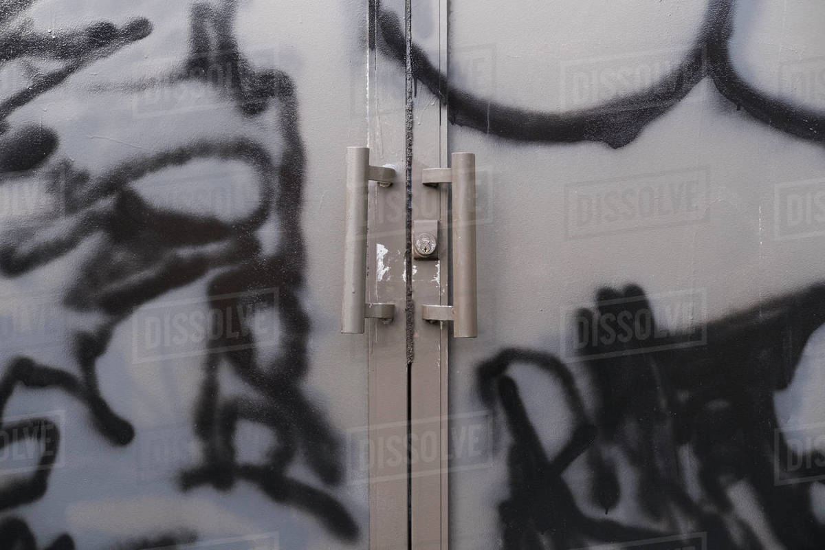 Graffiti and paint covered doorway  of abandoned office building Royalty-free stock photo