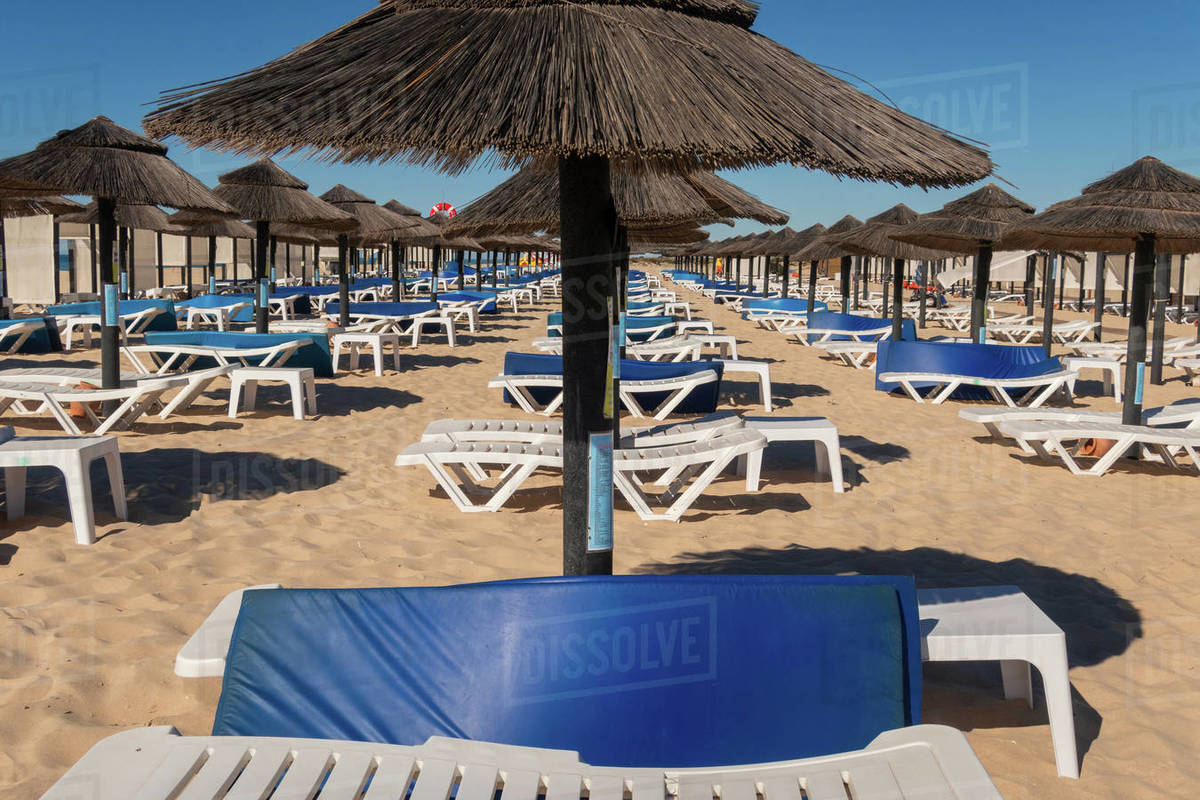 Beach parasols and sunloungers on the beach on Ilha de Tavira, Southern Algarve, Portugal Royalty-free stock photo
