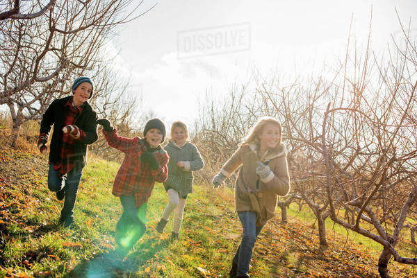 Four children running outdoors in winter  Royalty-free stock photo