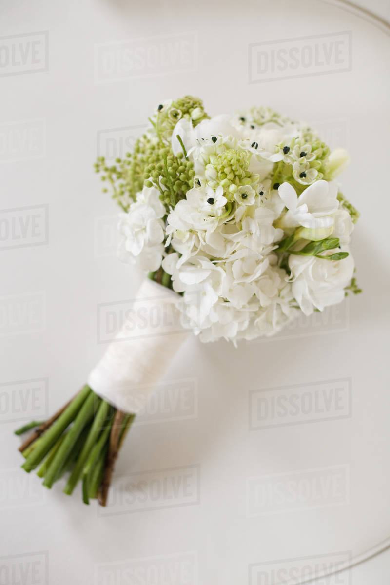 A Wedding Bouquet White Cut Flowers Green Seed Heads And Foliage