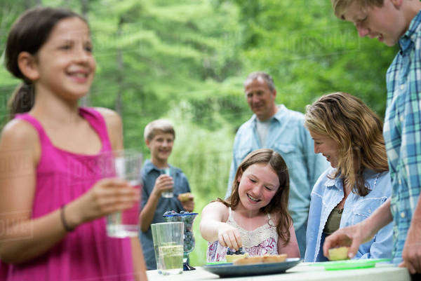 Organic Farm. An outdoor family party and picnic. Adults and children. Royalty-free stock photo