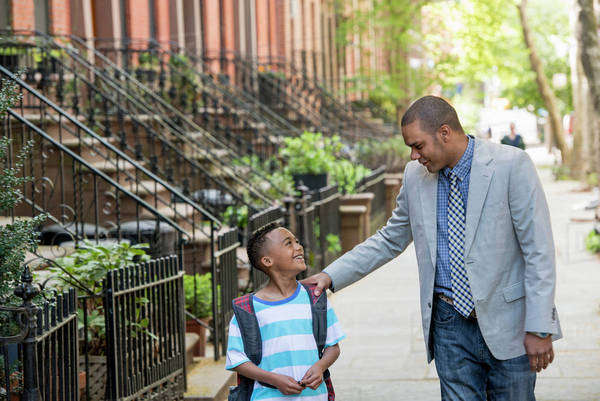 An Adult And A Child, A Father And Son, Walking Together On The Street In The City.  Royalty-free stock photo