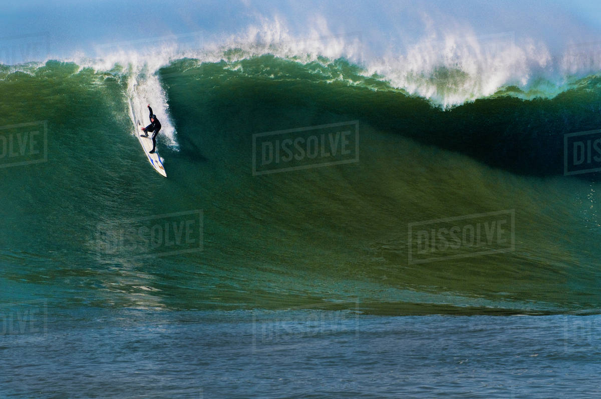 Surfer riding wave, Mavericks, Monterey Bay, California stock photo