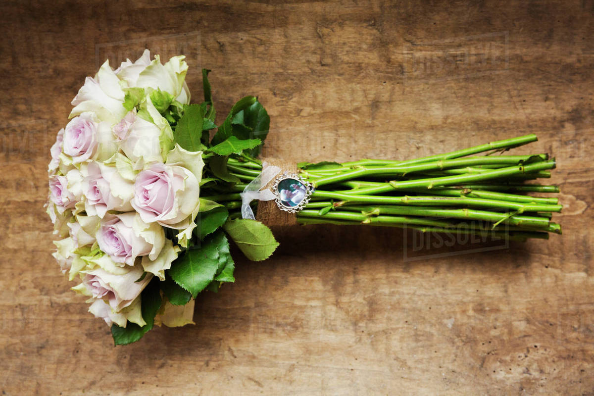 A Wedding Bouquet A Flower Arrangement Of Long Stemmed Pink Roses