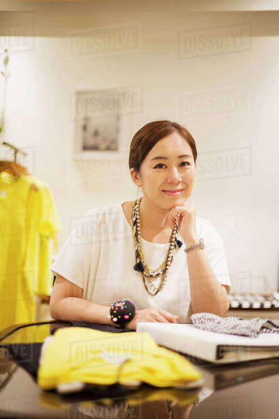 Woman working in a fashion boutique in Tokyo, Japan. Royalty-free stock photo