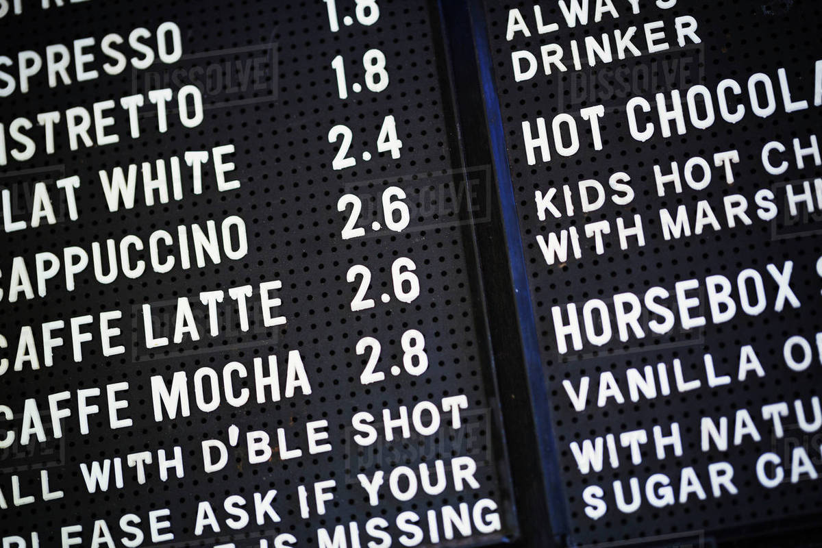 close up of a coffee shop menu on a blackboard. - stock photo - dissolve