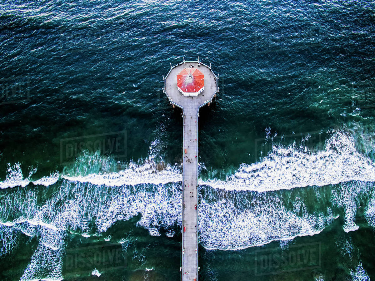 Aerial View Of The Manhattan Beach Pier And Waves Breaking On The