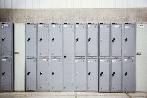 A row of grey metal lockers in a bicycle factory. Royalty-free stock photo