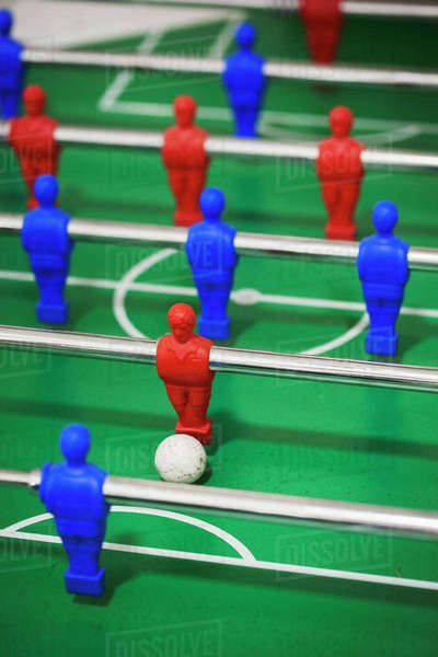 A table football gaming table, with the ball in play.  Royalty-free stock photo