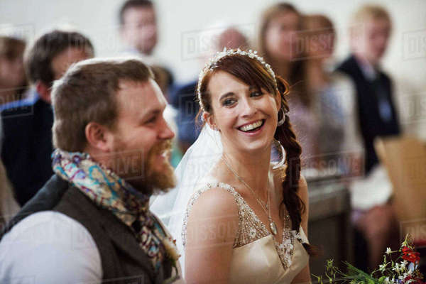 Smiling bride and groom at their church wedding. Royalty-free stock photo