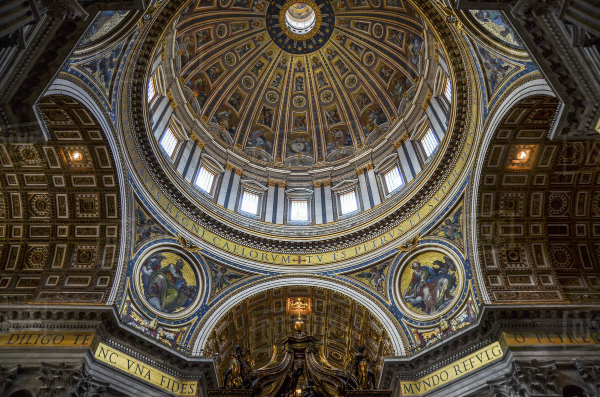 St Peter's Basilica in Rome, Italian Renaissance architecture, and UNESCO  world heritage site. Interior views, of the domed ceiling with sacred  artwork and frescoes. - Stock Photo - Dissolve