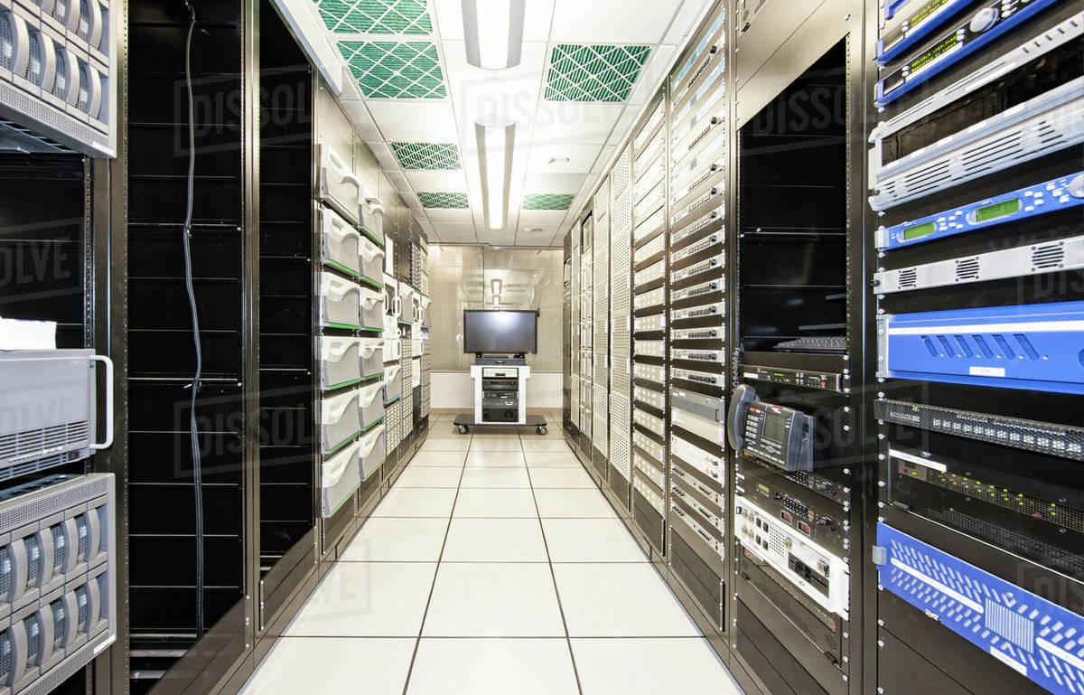storage racks aligned in a computer server room stock photo