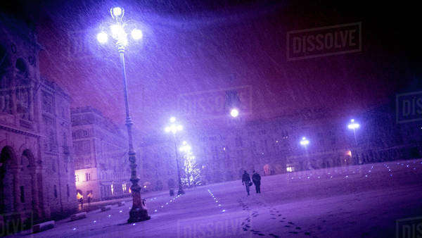 Piazza Unita d'Italia at night during a snowstorm in Trieste, Italy Royalty-free stock photo