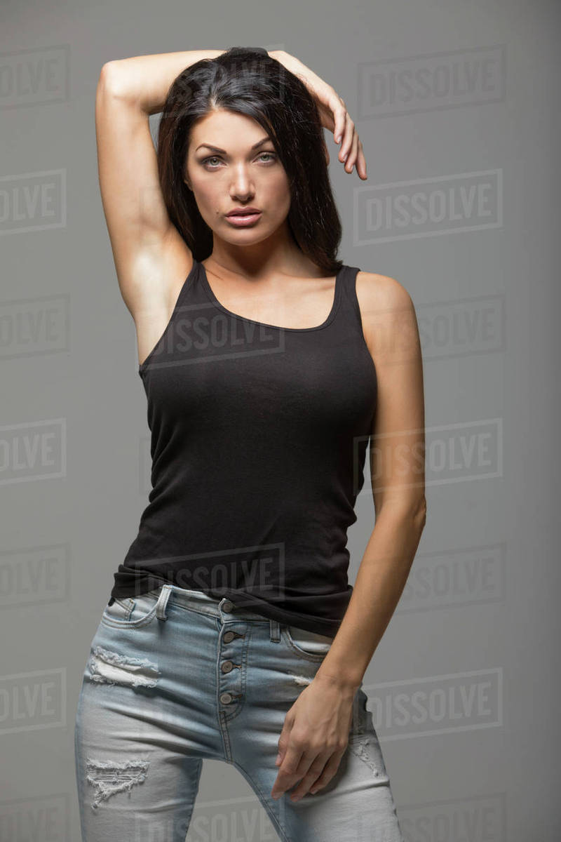 1c2bc0c0587b4 Portrait of brunette woman wearing black tank top - Stock Photo ...