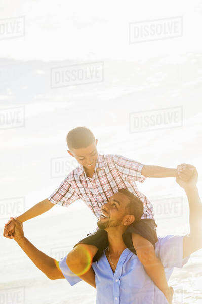 Father and son (10-11) having fun Royalty-free stock photo