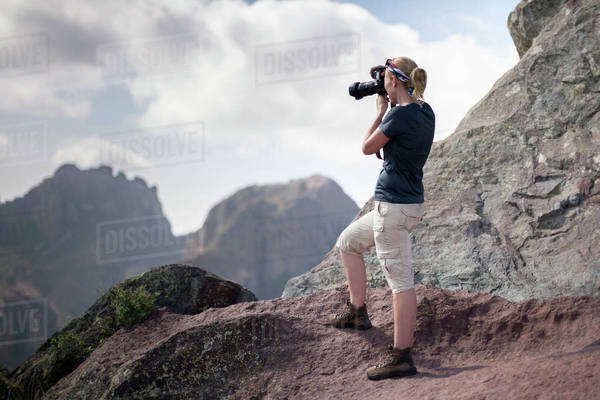 Woman photographing in mountains Royalty-free stock photo