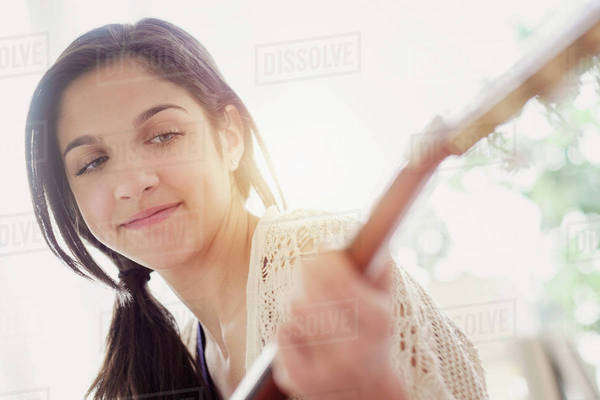 Teenage girl (14-15) playing guitar Royalty-free stock photo