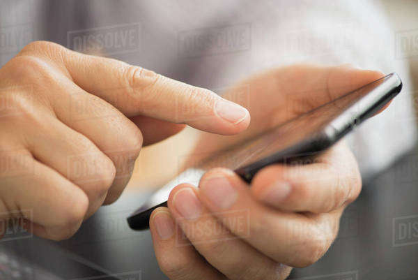 Close-up of hands using smartphone Royalty-free stock photo