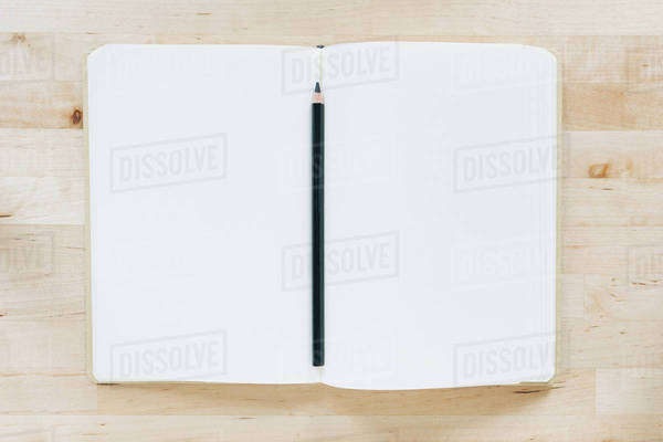 Overhead view of pencil in notebook Royalty-free stock photo