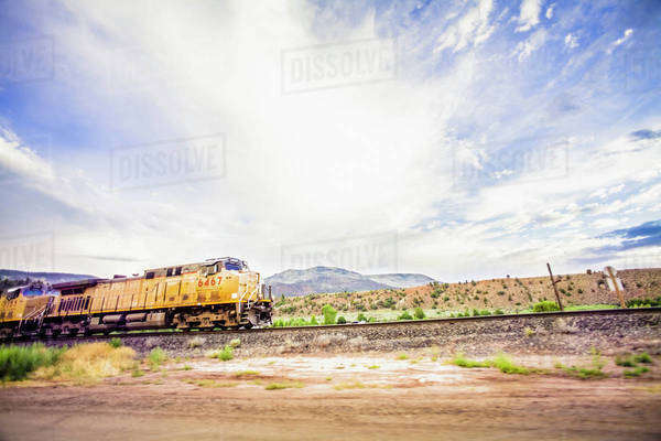 Train on railroad tracks in countryside Royalty-free stock photo