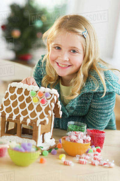 Girl (8--9) making gingerbread house Royalty-free stock photo