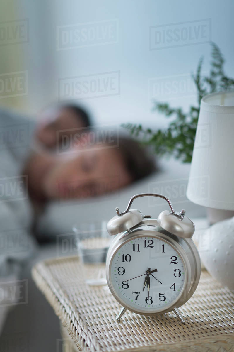Alarm clock in bedroom stock photo