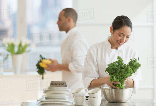 Couple during preparations in kitchen of their own restaurant Royalty-free stock photo