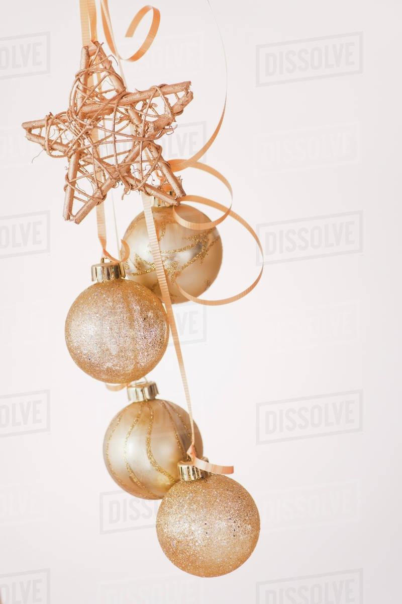 Studio Shot Of Gold Christmas Ornaments Stock Photo