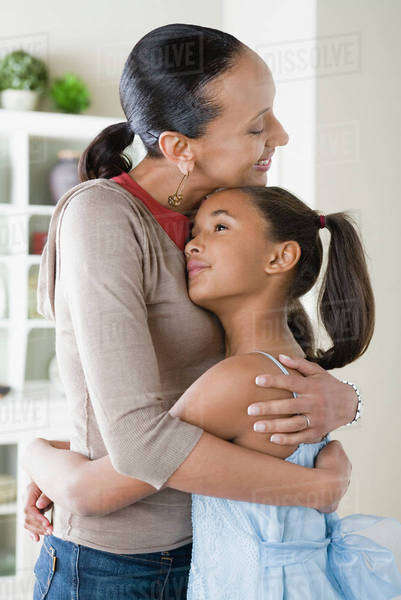 Mother and Daughter (10-11) hugging Royalty-free stock photo
