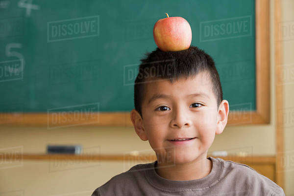 Boy (6-7) with apple on his head Royalty-free stock photo