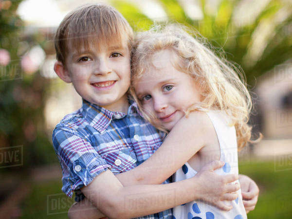 Outdoor portrait of girl (4-5) and boy (6-7)  Royalty-free stock photo