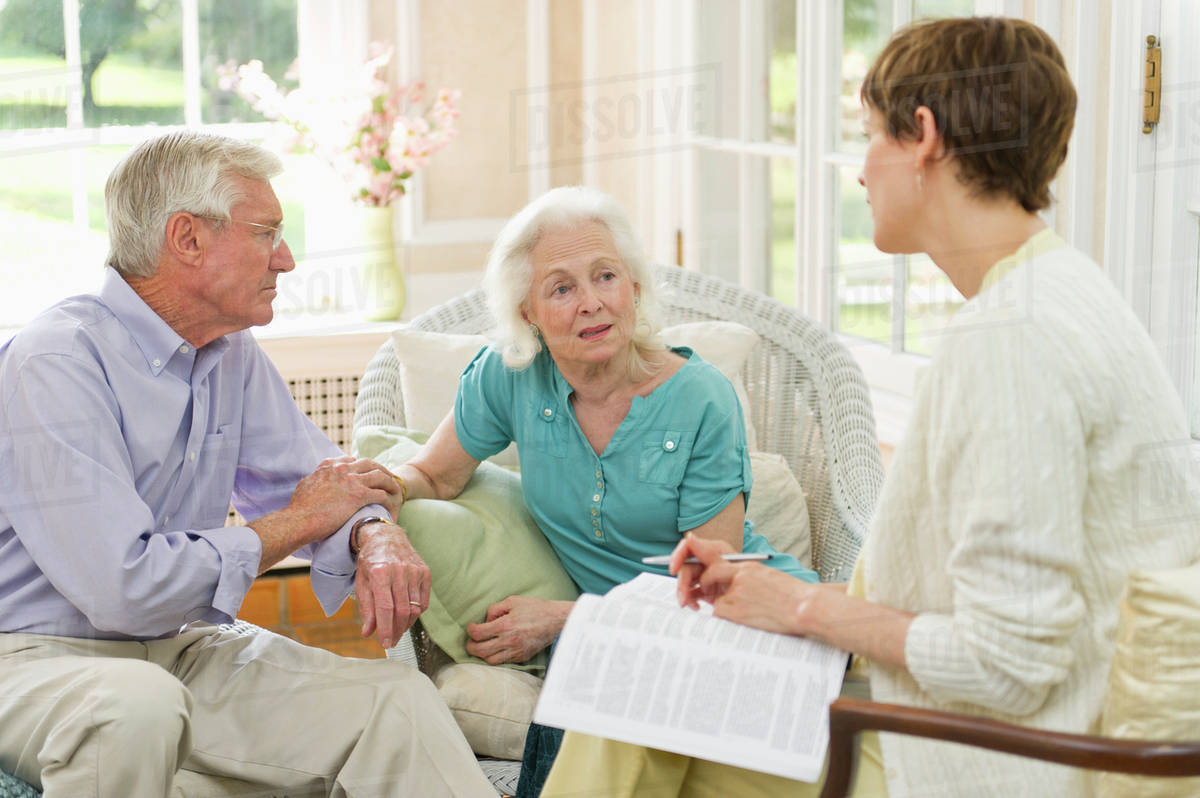 Nursing Assistant Talking With Seniors In Nursing Home Stock Photo Dissolve